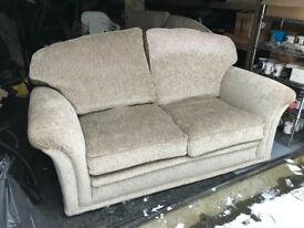 Pair of two seater sofas in beige