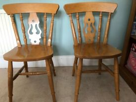 Set of 8 pine dining/kitchen chairs, 6 full size + two slightly smaller all matching. £150 the set