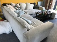Reasonable condition 5 seated fabric L shaped sofa.