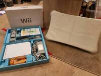 Nintendo Wii Console With Wii remote, Numchuck, Wii fit board & Brand New Wii Fit Plus Game