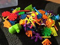 Box of plastic educational toys