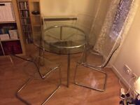 IKEA 'Salmi' glass/chrome plated table and four IKEA 'Tobias' transparent/chrome plated chairs