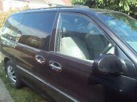 Black kia sedona se 2902 cc runs good manual leather seats e/w