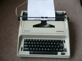 Olympia Reporter Typewriter with instructions and hard case