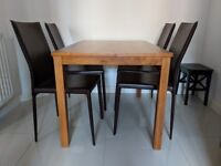 Solid wood dining table and 4 brown chairs with steel frame
