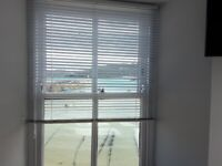 5 white venetian blinds