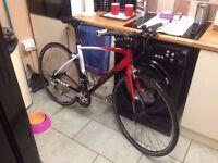 giant defy entry level flat bar road bike carbon forks super light weight smooth ride bargain