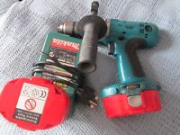 Makita drill with batteries and charger