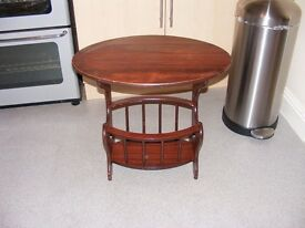 For sale:- A mahogany coloured combined magazine rack and side table