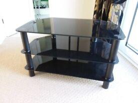 Black smoked glass TV stand 80cms x 45cms. 2 x shelves