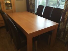 Solid dining table, 6 chairs & matching Cabinet