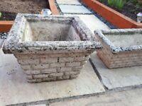 3 stone garden planters. 2 square and 1 trough