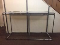 Glass topped chrome display unit