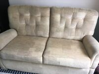 2 Seater Sofa - with drop down arms. In very good condition. Collection only.