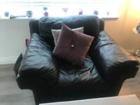 Black l shaped leather sofa and chair