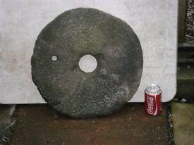 granite millstone for grinding grain or for garden decor............................................