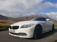 BMW Z4 28si in Alpine White with red leather heated seats.