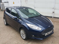 automatic FORD FIESTA TITANIUM 2012 FACELIFT MODEL. ONLY 14 K MILES. 1 YEAR MOT. PARKING SENSORS