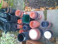 loads of plastic plant pots for sale. all stored in the dry etc