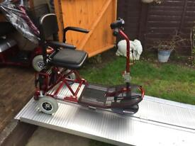 Ultra lightweight compact ex demo mobility scooter 9st user - brand new batteries today . Just £290