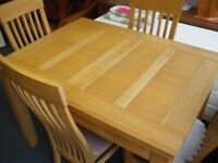 EXTENDING TABLE AND 4 CHAIRS at Haven Housing Trust's charity shop