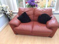 Brown leather deep cushioned sofa