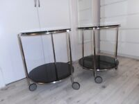 Pair round coffee/trolley tables