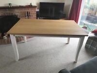 A new Julian Bowen Davenport Oak Dining Table