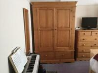 Two large pine wardrobes