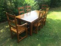 Solid oak farmhouse style table and six oak chairs