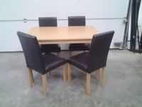 Ex display Bargain. Dining table and 4 faux leather chairs in choc brown. Can deliver.