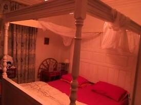 Handmade wooden four poster bed and superking mattress