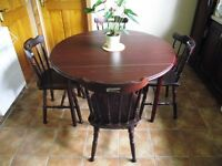 Dining table drop leaf and four chairs in very good condition.