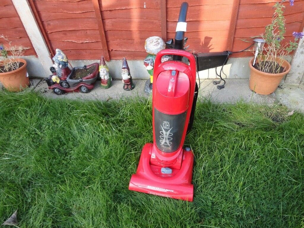 nice clean pink hoover in good working order handle drops down