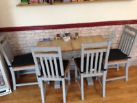 Three tables with six chairs