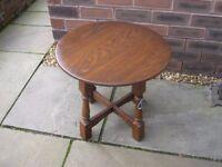 A Jaycee Furniture round coffee table.