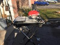 Selling Husky tile saw with stand