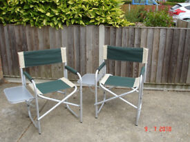 A pair of directors chairs with attached side table.