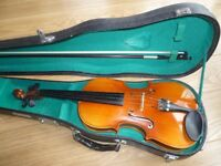 Student 3/4 violin by Skylark and music stand