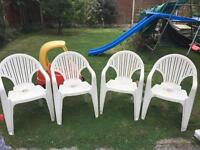 4 white plastic patio chairs