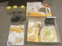 Medula swing electric breast pump (single) with new filters, calma teat and 3 bottles.