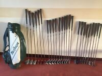 25 used golf clubs and bag.