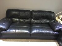 Black leather sofa.