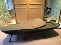 Camping bed with mattress
