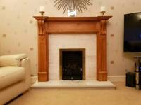 Living flame gas fire with pine surround