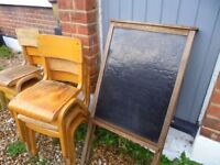 Black board and small wooden chairs