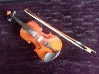 Half size violin, case and rosin provided.