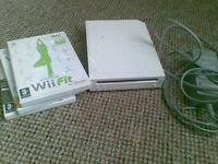 Nintendo Wii console with 3 games (Wii fit etc...)