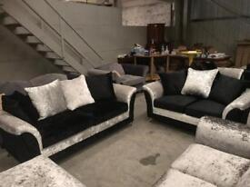 Brand new black and silver 3+2 crushed velvet sofa suite