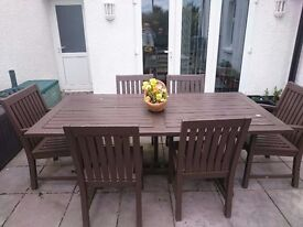 Large hardwood garden table and six chairs